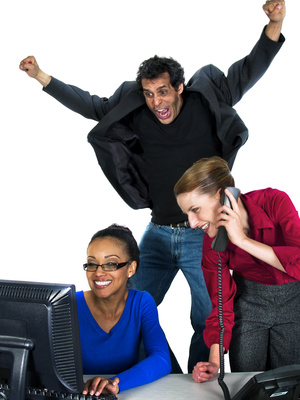 Photo of a business team celebrating a successful moment.